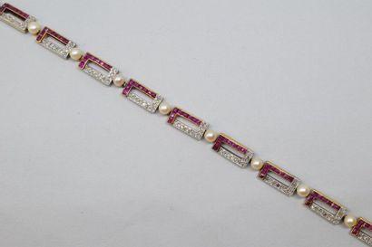 Bracelet souple or jaune et or gris 18k (750)...