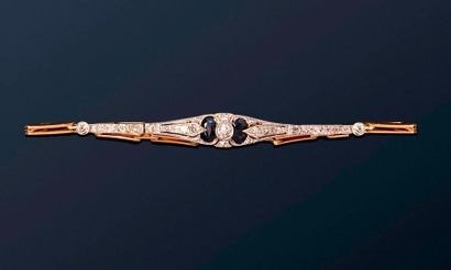 Bracelet souple or jaune 18k (750) et platine...