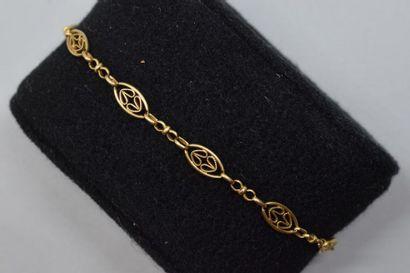 Bracelet en or jaune 18k (750) et argent...