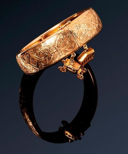 Bracelet rigide ouvrant or jaune 18k (750)...