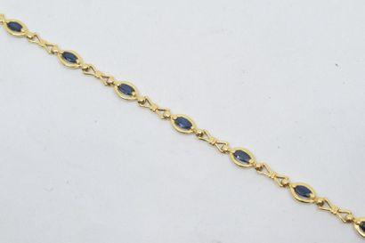 Bracelet en or jaune 18k (750) orné de saphirs...