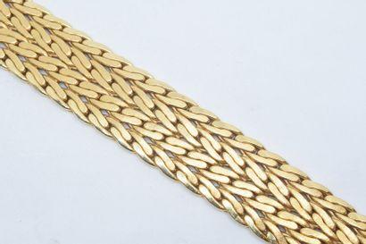 Bracelet en or jaune 18k (750) formant quatre...