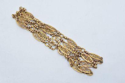 Bracelet en or jaune 18k (750) à trois lignes...