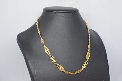 Collier ajouré en or jaune 18k (750) à maille...
