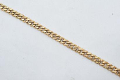 Bracelet en or jaune 18k (750) à maille gourmette....