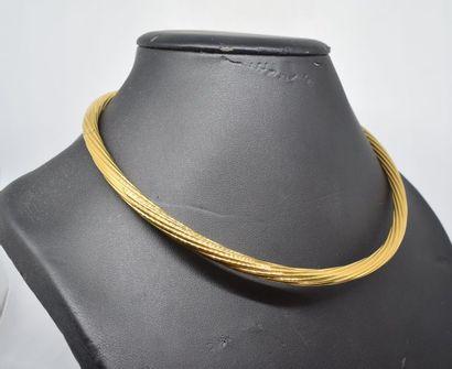Collier rigide en or jaune 18k (750) à maille...