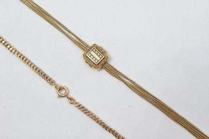 Chaîne giletière en or jaune 18k (750) et...