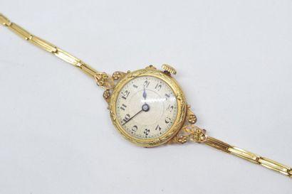 Montre bracelet, boîtier rond en or jaune...