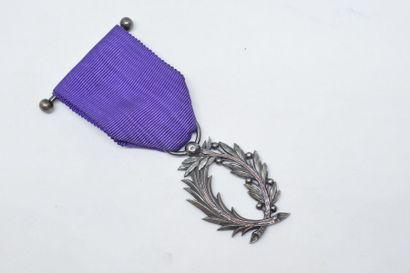 Médaille de l'Ordre des Palmes Académiques....