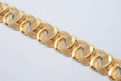 Bracelet souple en or jaune 18K (750) articulé...