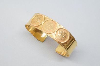 Bracelet rigide en or jaune 18K (750) formé...