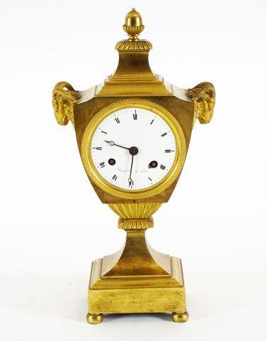 Pendule de cheminée Louis X en bronze doré...