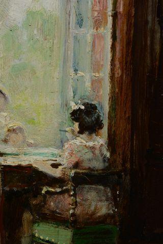 HERVÉ, Jules René (1887-1981)  Jeune fille à son bureau  Huile sur panneau  Signée...