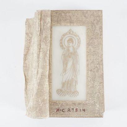 Livre au écritures bouddhistes, réhaussées...