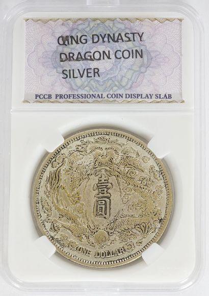 Monnaie Dragon dans son étui.  Poids : 26.03g