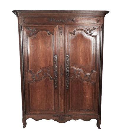 Armoire époque XVIII en bois naturel finement...