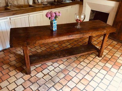 Table en orme et bois fruitier, pieds chanfreinés...