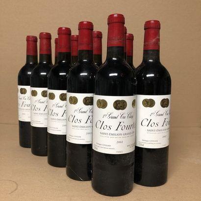 12 bouteilles CLOS FOURTET 2002 1er GCC (B)...