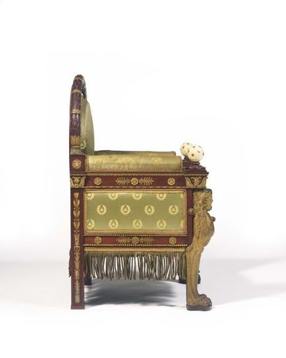 Mahogany throne, mahogany veneer and gilded wood, with a wide medallion backrest,...