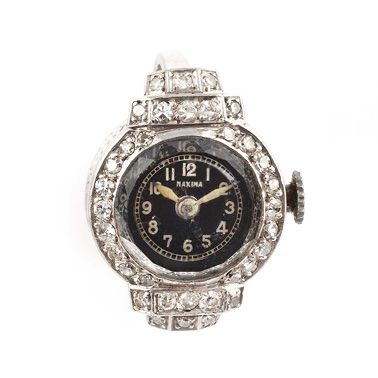 RING WATCH, Maxima around 1950 Platinum setting, diamonds on the bezel and shoulders....