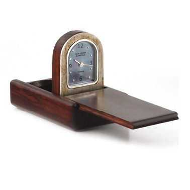 """VAN CLEEF & ARPELS """"Domino"""" Travel clock mounted in a domino made of amourette wood..."""