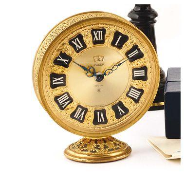 JAEGER, clock around 1960. Ringing desk clock. Round case in gilded metal, case...