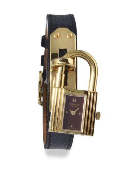"HERMES Paris ""KELLY"" around 2015. Women's gold-plated steel padlock watch. Rectangular..."