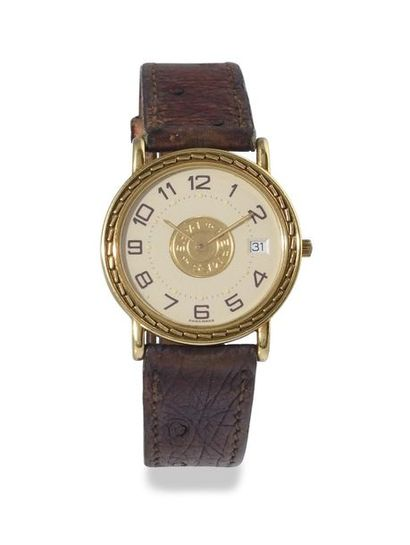 """HERMES Paris """"Sellier"""" around 2005 18k yellow gold bracelet watch. Gold and godronnée..."""