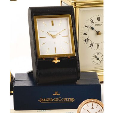 """JAEGER-LECOULTRE """"ADOS"""", VERS 1960 Teenage gilded metal travel clock, white hour-marker,..."""