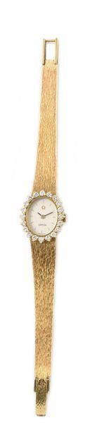 OMEGA around 1960 Lady's watch in 18k yellow gold and diamonds. Oval case set with...