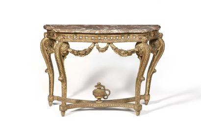 Table console en bois doré de forme mouvementée,...