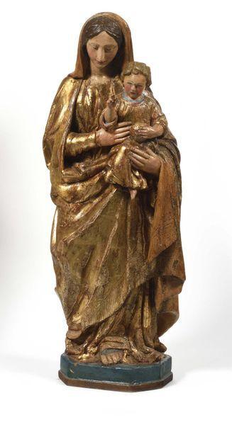 Vierge à l'Enfant en bois sculpté en ronde-bosse,...