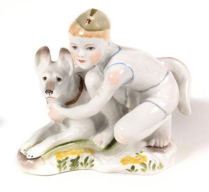 Figurine « Garçon avec un chien »  Porcelaine...