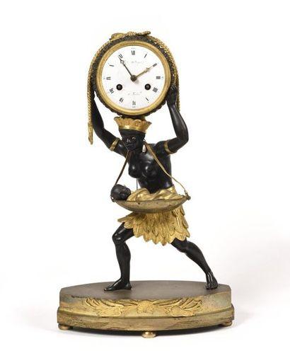 """PENDULE dite """"LA NOURRICE AFRICAINE"""" en bronze ciselé en partie doré et en partie..."""