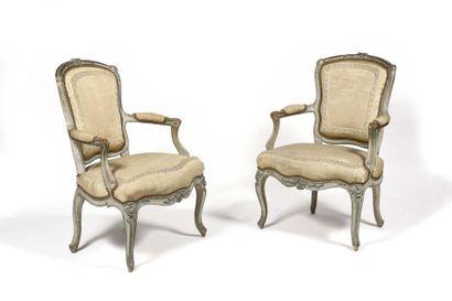 Suite de quatre fauteuils en hêtre peint...