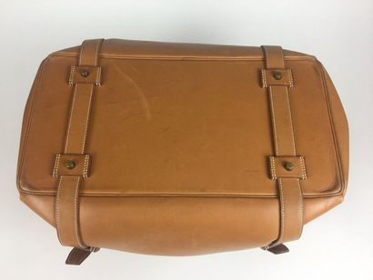 HERMES Travel bag DRAG 50 in gold leather, notched flap, belt buckles, double handle....