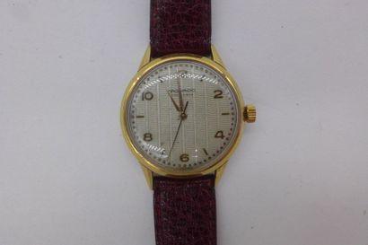 MOVADO VERS 1960 Montre bracelet pour homme en plaqué or jaune, cadran doré, index...