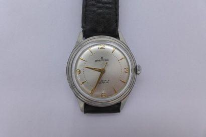 BREITLING Années 1960 Montre d'homme ronde, fond vissé, en acier. Cadran argenté,...