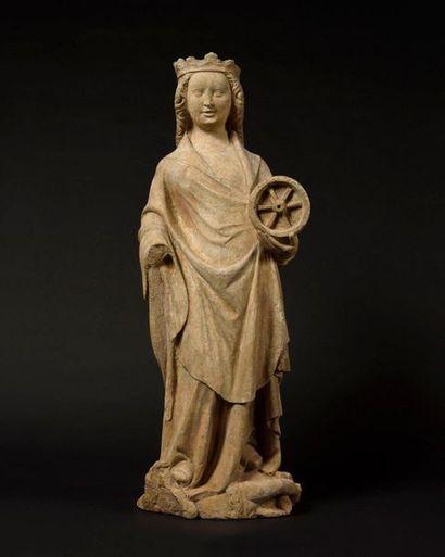 Sainte Catherine d'Alexandrie en pierre calcaire...