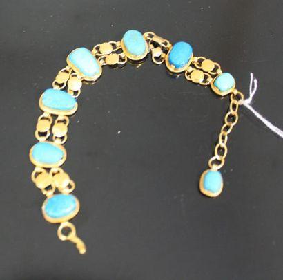 BRACELET en or jaune orné de sept turquoises...