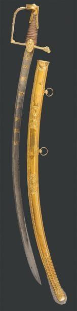 Superbe sabre ayant appartenu au Général Macdonald. Poignée entièrement filigranée...