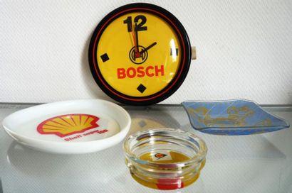 Lot comprenant une horloge Bosch, un vide...