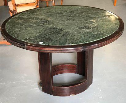TABLE ronde sur pietement ovale à plateau...