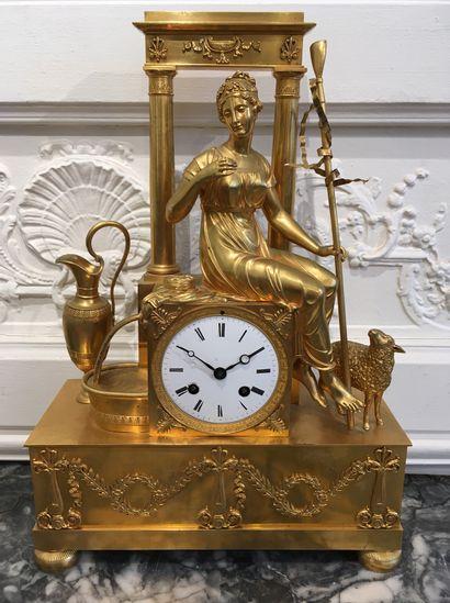 PENDULE en bronze doré représentant une jeune...