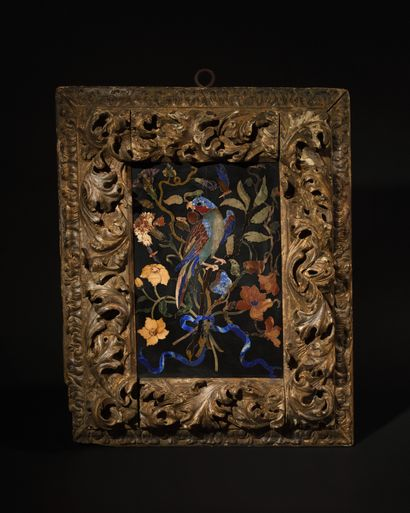 A PAIR OF PANELS in polychrome marquetry of hard stones representing a parrot in...