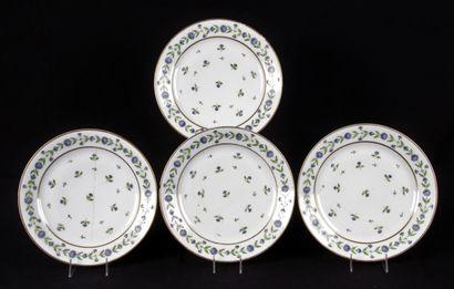 PARIS. Suite de quatre assiettes en porcelaine...