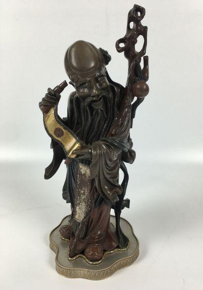 CHINE Grande figurine en bois sculpté et...