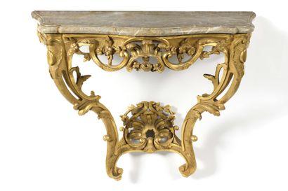 CONSOLE en bois doré mouluré et sculpté à...