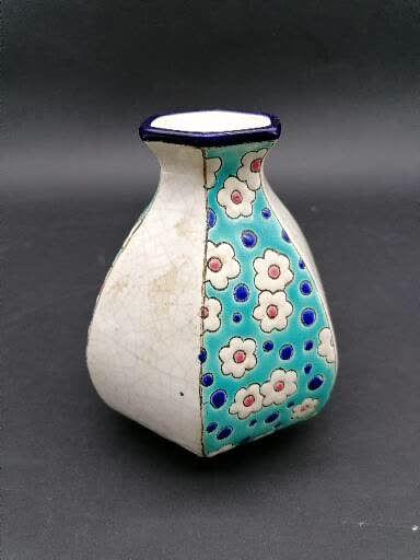 LONGWY  Petit vase en faience émaillé  A fond bleu à décor de fleur et blanc craquelé...