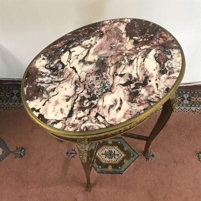 SALON TABLE  Louis XV style, made of veneer and gilt bronze, pink marble top.  Rich...